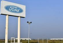 Signage for Ford Motor stands at its Vehicle Assembly and Engine Plant in Sanand, Gujarat