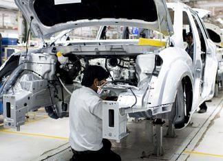 An employee works at Mahindra & Mahindra Ltd. facility in Chakan, Maharashtra   Representational image   Bloomberg