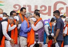 Newly sworn-in Gujarat cabinet members and former state CM Vijay Rupani after the cabinet swearing in Thursday | PTI