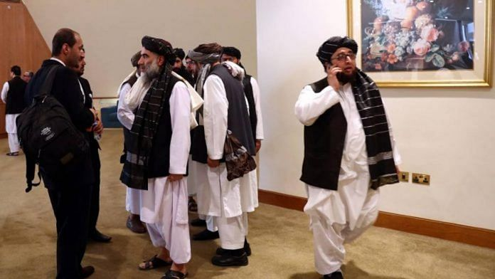 File photo of members of Afghanistan's Taliban delegation ahead of an agreement signing between them and US officials in Doha, Qatar in February 2020 | ANI via Reuters