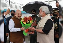 Union Home Minister Amit Shah being received by LG of J&K Manoj Sinha on his arrival in Srinagar, on 23 October 2021 | PTI