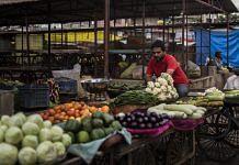 A vendor at a vegetable and fruit wholesale market in Guna, Madhya Pradesh | Photographer: Anindito Mukherjee | Bloomberg