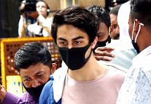 Bollywood actor Shah Rukh Khan's son Aryan Khan being escorted at the NCB office after a medical check-up in Mumbai, on 7 October 202