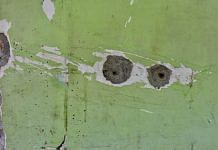 (Representational image) Bullet holes in the walls of the school in Srinagar where a principal and the teacher were killed earlier this month   Photo: Suraj Singh Bisht/ThePrint