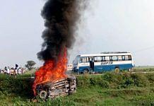 A vehicle set ablaze at Lakhimpur Kheri during the 3 October violence | ANI photo