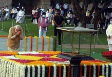 Prime Minister Narendra Modi pays homage to Mahatma Gandhi on the occasion of his birth anniversary, at Rajghat in New Delhi   Photo: Praveen Jain   ThePrint