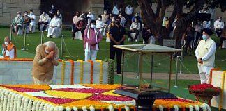Prime Minister Narendra Modi pays homage to Mahatma Gandhi on the occasion of his birth anniversary, at Rajghat in New Delhi | Photo: Praveen Jain | ThePrint