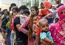 Beneficiaries wait to receive Covid-19 vaccine dose at a free vaccination camp organized by the Delhi government, on 10 October 2021 | PTI