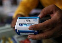 A storekeeper uses a Paytm All-In-One POS payment device at a medical store in Mumbai | Photo: Dhiraj Singh | Bloomberg