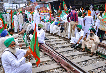 Members of various farmers organizations block railway tracks during a protest against Central government in Patiala, on 18 October 2021.