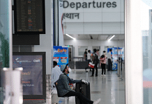 A traveller wearing a mask sits in a departure hall at the Indira Gandhi International Airport in New Delhi | Representational image | T. Narayan | Bloomberg