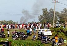 A vehicle set ablaze after violence broke out after farmers agitating were allegedly run over by a vehicle in the convoy of a union minister, in Lakhimpur Kheri on 3 October   PTI