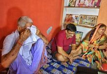 (From L) BJP block president Shubham Mishra's grandfather Shyam Manohar, father Vijay Mishra and mother Sushma at their house in Lakhimpur city | Praveen Jain | ThePrint