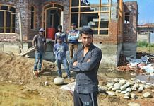 Sameer Wani, a local contractor in Eidgah, with a group of migrant workers he brought to Kashmir | Praveen Jain | ThePrint