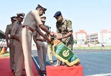 Snowy receives the 'best dog' medal from ITBP Director General Sanjay Arora during the Dg's parade Saturday. | By special arrangement