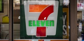A signage displayed outside a 7-Eleven store in Chicago, Illinois   Photo: Christopher Dilts   Bloomberg Photo